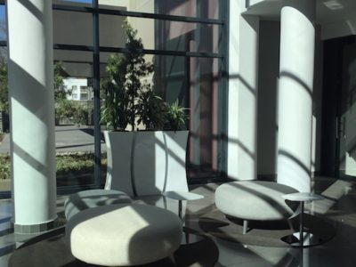 White powder coated aluminium planters in Fat and Thin shape at Athol Towers
